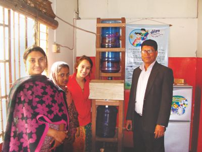 Sabera Talukder installing her water purification system in daycares for street children in Dhaka, Bangladesh.