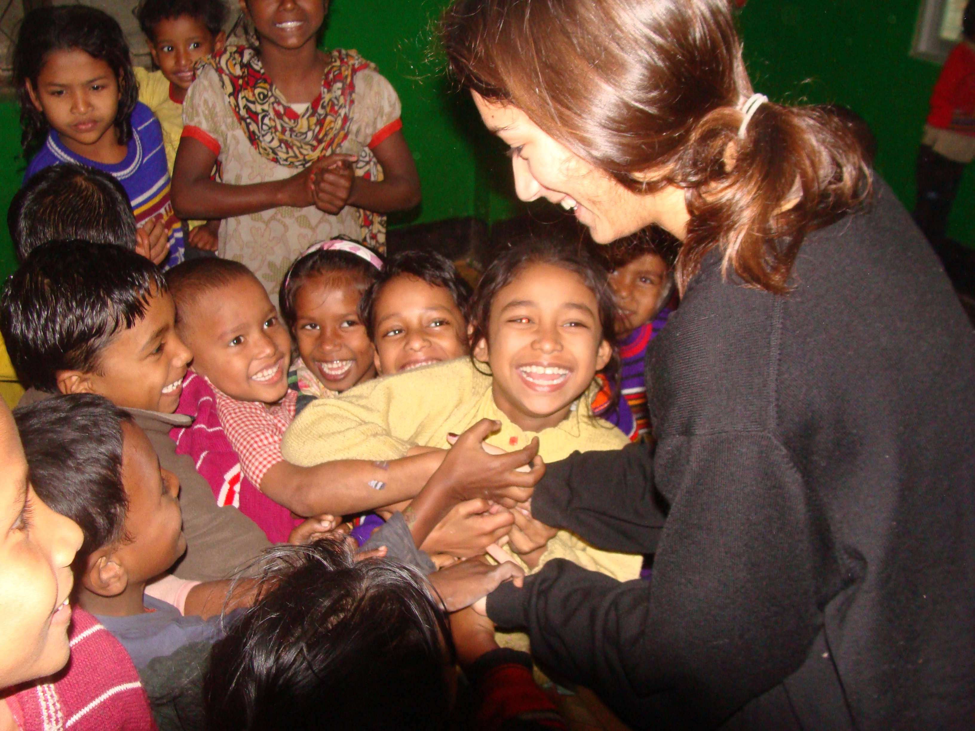 Sabera Talukder meeting children from the daycares for street children in Dhaka, Bangladesh.